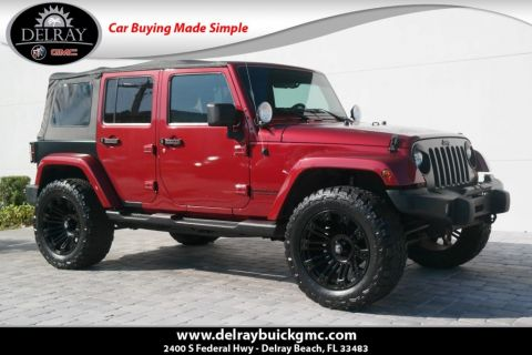 Pre-Owned 2012 Jeep Wrangler Unlimited Sahara With Navigation & 4WD